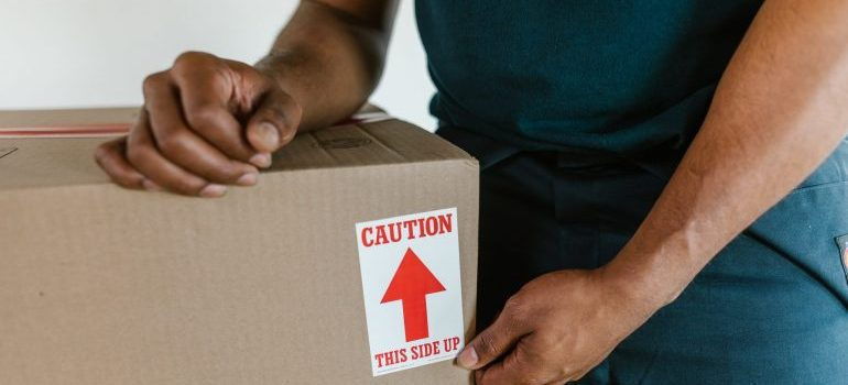 A man packing a moving box