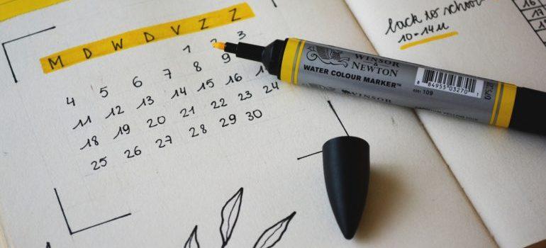 calendar in a notebook and a marker