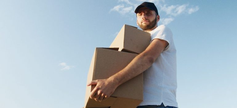 A professional mover caring boxes, representing downtown toronto movers