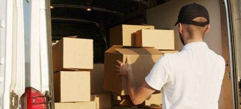 a man loading a truck