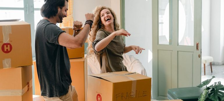 A happy couple and moving boxes