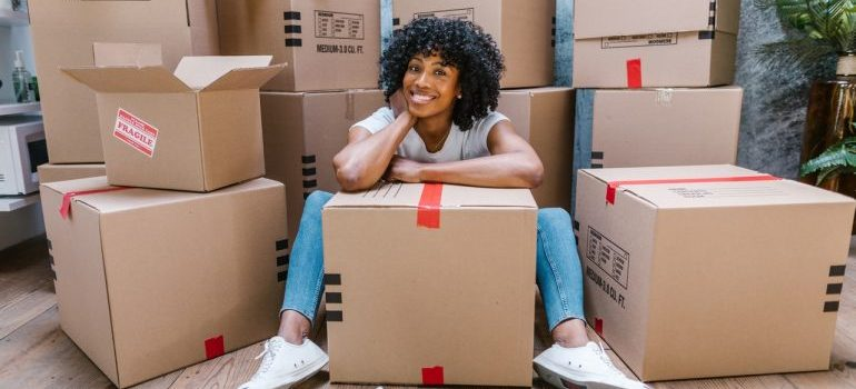 A woman surrounded by moving boxes