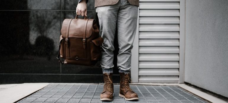 person holding a traveling bag