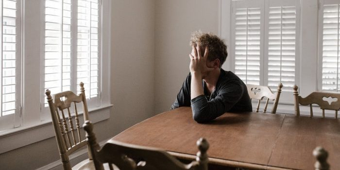 A picture of a man sitting at a table