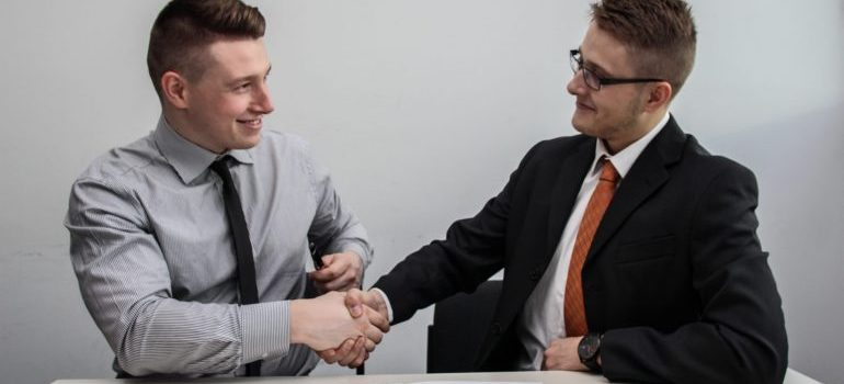 Two people share a handshake