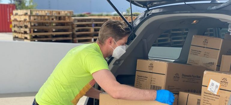 man loading the moving boxes