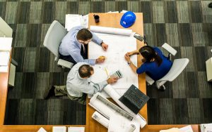Employers gathered around an office table