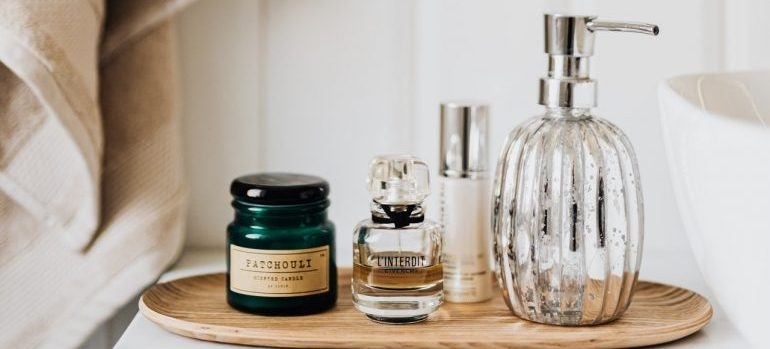Cosmetics glass bottles on a wooden tray