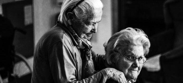Two elder women in a senior facility