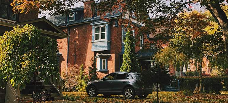 A car in front of a home