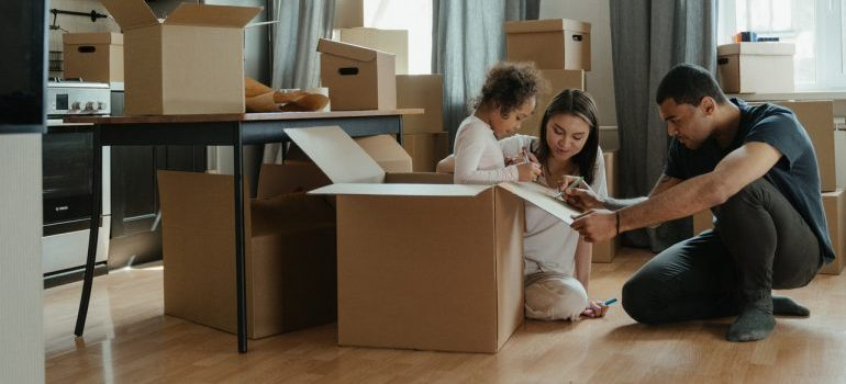 A family packing up their boxes to relocate to Aurora