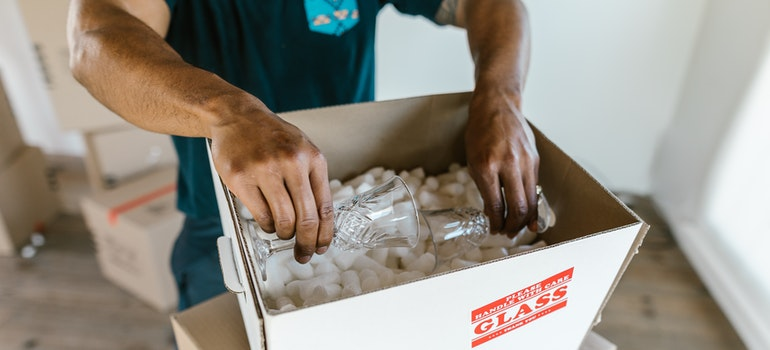 a man packing glass items