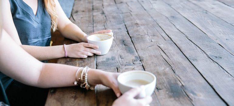 Woman talking ad drinking coffee