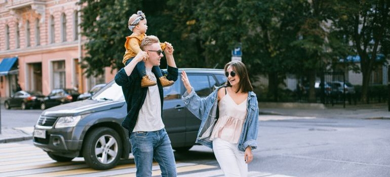 A family crossing the street.