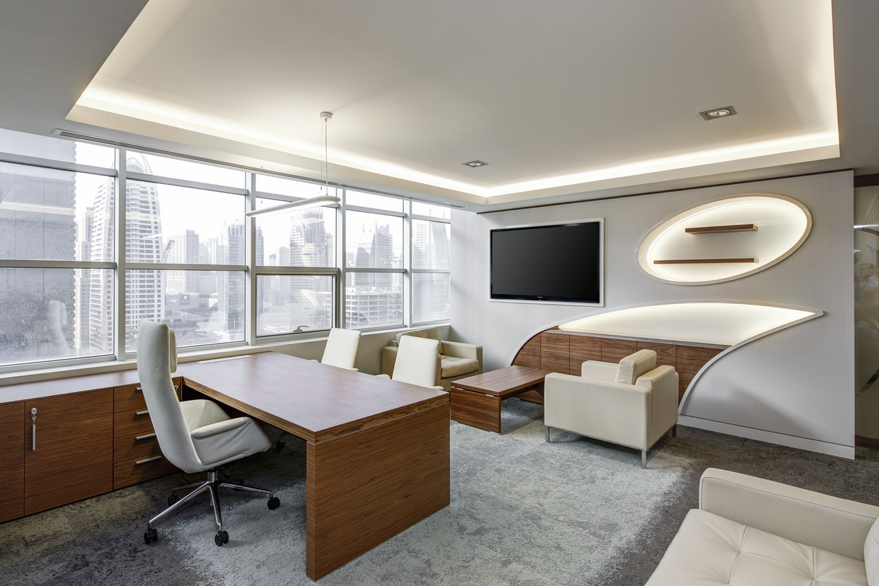 white office with desk and chairs