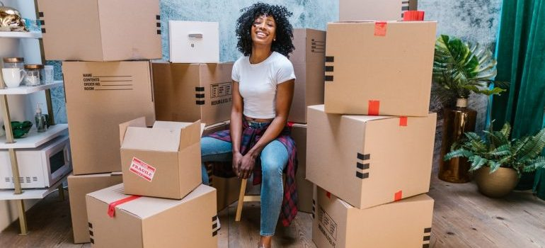 Woman sitting next to the boxes