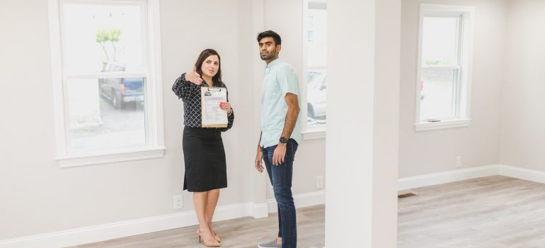 a man talking to his real estate agent prior to buying a property in Toronto