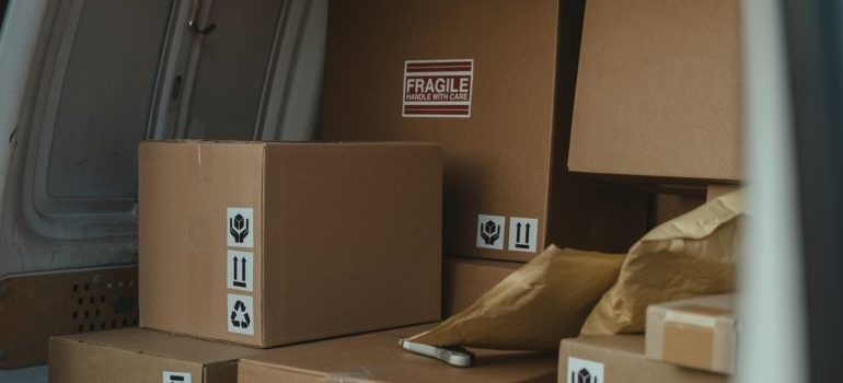 Labeled boxes loaded in a moving vehicle
